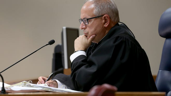 Monroe County Court Judge James Piampiano during opening remarks in the Charles Tan case.