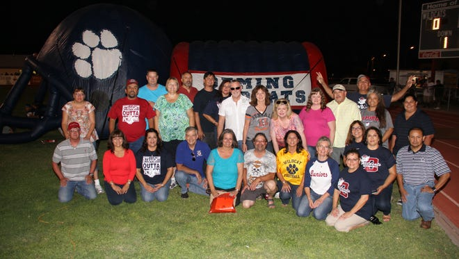 Several members of the Deming High School Class of the 1980s returned to Deming this past weekend to celebrate the 2015 Wildcat Homecoming. The group attended the Homecoming football game and posed for this photo at half time. They also celebrated with a meet-n-greet on at a local sports bar and held a dinner and dance, featuring the Clay Mac Band and Dana.