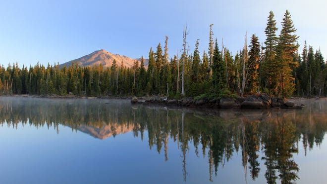 One of the many islands of Summit Lake is seen below Diamond Peak in Deschutes National Forest southeast of Oakridge. .