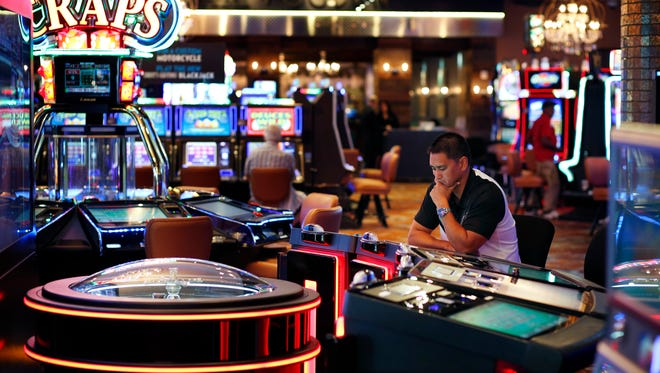 A man plays an electronic roulette game at the Downtown Grand hotel and casino in Las Vegas. As gamblers move away from traditional slot machines, game-makers and casinos are looking at new ways to keep people playing.