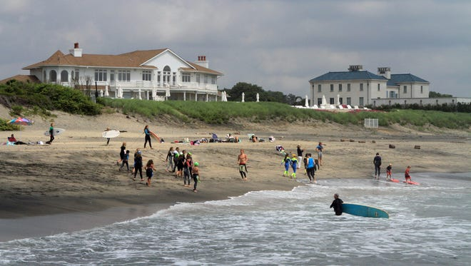 Surfers enjoy the waves  at  Phillips Avenue in Deal in 2014, prior to the start of the $40 million beach replenishment project