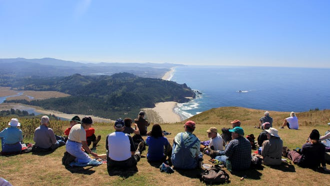 The crowds on the Oregon Coast have increased over the past five years. Seen here is a group atop Cascade Head in late August.