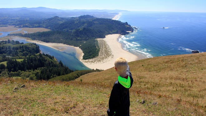 Noah Peters checks out the view at the overlook at the top of the Nature Conservancy's Cascade Head Trail.