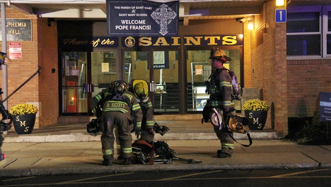 Firefighters respond to the fire that broke out Tuesday night at Saint Mary's Elementary School in Middletown.