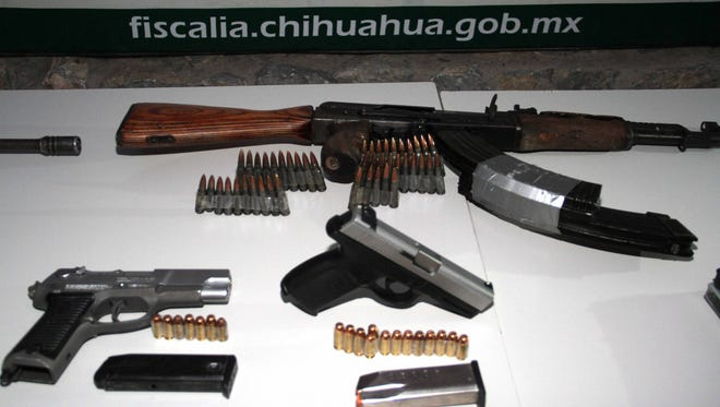 Some of the weapons seized in connection with the killing of a Chihuahua state police commander in Juárez on Saturday.