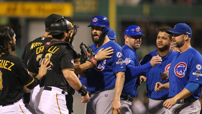 Cubs starting pitcher Jake Arrieta reacts after he was hit by a pitch.