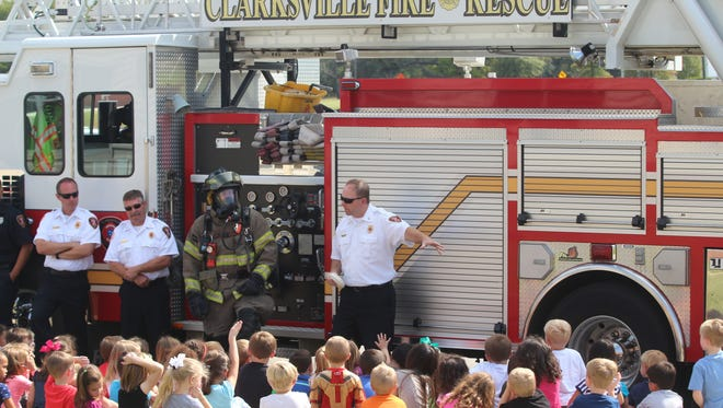 Clarksville Fire Rescue Capt. Ricky Cumberland tells kindergartners at Rossview Elementary about the importance of having a smoke detector Thursday.