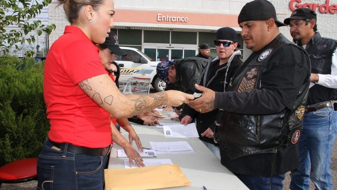Jeca Jara registered Victor Pena for the Shop With A Cop benefit bike run held Saturday in Deming. Law Enforcement motorcycle clubs participated in the event, along with bikers from the area to kick off the fund-raising season for the local Shop With A Cop program. The program hands out Kmart gift cards to over 350 children in Deming to shop with a member of local law enforcement and make their Christmas wishes come true. The program is funded primarily by the business community and through fund raisers throughout the year under the supervision of the Luna County Sheriff's Office.