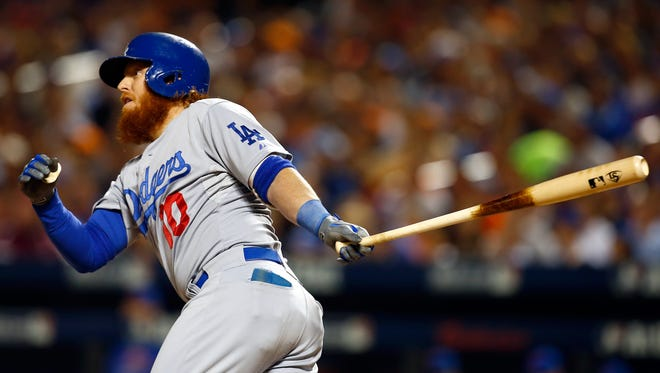 Justin Turner hits a double to score Howie Kendrick and Adrian Gonzalez in the third inning.