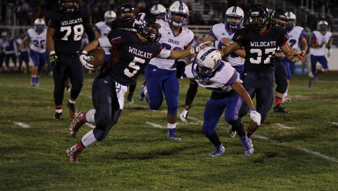 Senior back Carlos Armendariz (5) has shown breakaway speed running off the edge for the Deming Wildcats. The Wildcats will need a solid running game to keep the Onate Knights triple-option offense off the field in Friday's 7 p.m. kick off at the Field of Dreams in Las Cruces.