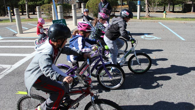 Youngster shove off on the Fun Ride at Solomon Schechter of Westchester's Hartsdale campus on Sunday.