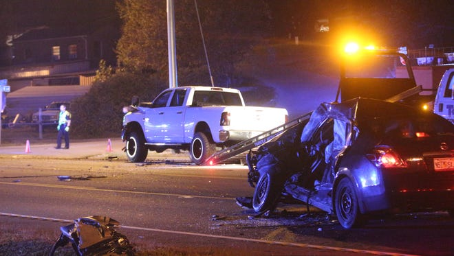 Crews prepare to tow the two cars involved in Monday night's wreck on the 41A Bypass.