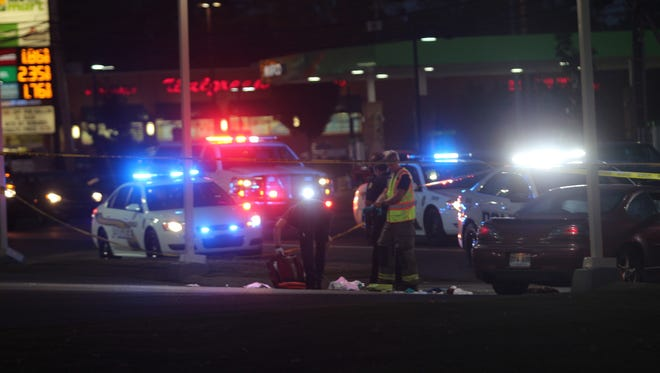Emergency responders clear medical debris from the scene of a shooting at the BP on Wilma Rudolph Boulevard Tuesday night.