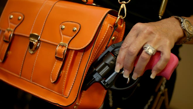 County commissioners are considering allowing residents to carry concealed firearms into county government buildings.