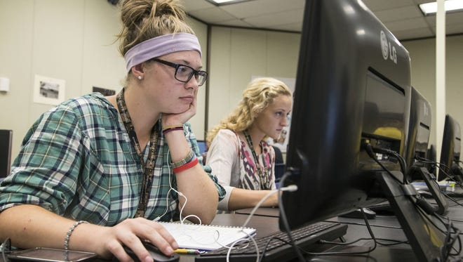 Shadow Mountain High School student Monquie LaGrange (left) and Nicole Larimore take classes online at their homes but also use a computer lab at school.