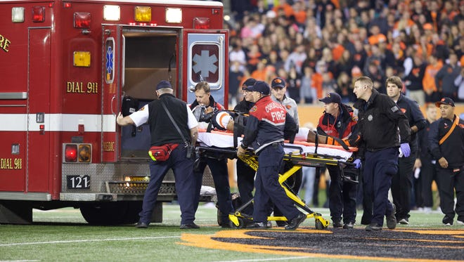 Oct 24, 2015; Corvallis, OR, USA; Oregon State Beavers cornerback Treston Decoud (14) is taken off the field on a backboard and moved into the ambulance as Colorado Buffaloes team members neal on the sideline at Reser Stadium. Mandatory Credit: Scott Olmos-USA TODAY Sports