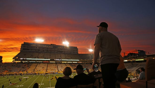 Fans arrive to watch a colorful sunset as Colorado plays ASU at Sun Devil Stadium on Oct. 10, 2015 in Tempe, AZ.