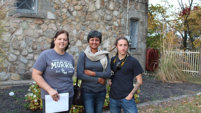 Stacy Webb, Nisha Khanna and Brian Ensminger, Landscape and Horticultural Technology students at County College of Morris, on site at the Lake Hopatcong train station where they will be assisting with designing a sustainable landscape for the historic property.