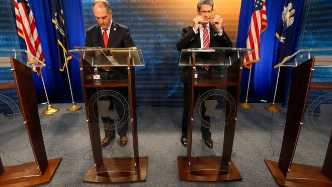 Gubernatorial candidates, state Rep. John Bel Edwards, D-Baton Rouge, left, and U.S. Sen. David Vitter, R-La., take their places before a debate, sponsored by WDSU television, at their studio in New Orleans, Thursday, Oct. 1, 2015. (AP Photo/Gerald Herbert)