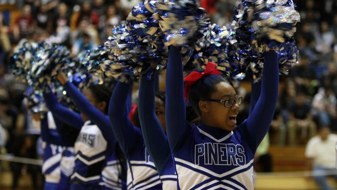 Janaee Johnson, 16, cheers with her squad during a pep rally at Lakewood High School on Oct. 29. Admission to the pep rallies is one of the rewards for good behavior.