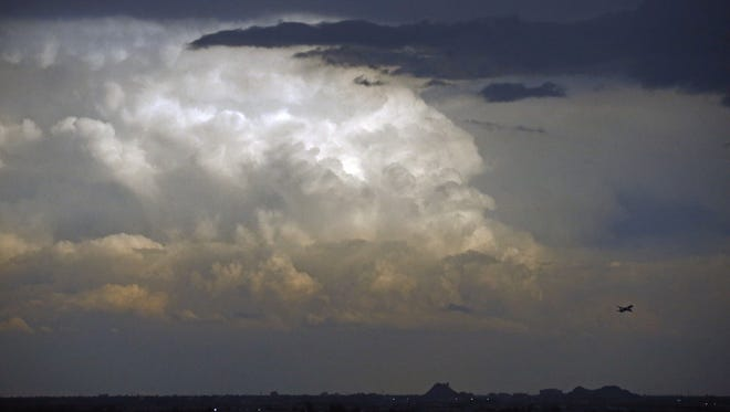 A late afternoon rain storm sweeps through the Phoenix area on Oct. 18, 2015.