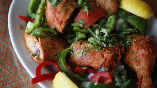 Chicken Tandoori, made with red and green bell peppers, onion and lemon, a traditional dish at Essence of India on Tuesday, Nov. 3, 2015.