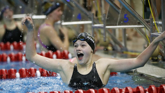 Southeast Polk's Lauryn Schieffer reacts as she sees her time in the 200 yard freestyle Saturday, Nov. 7, 2015, during the girls state swimming championships in Marshalltown.