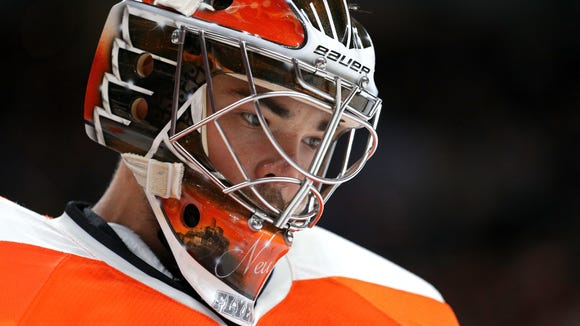 Goalie Michal Neuvirth collapsed on the ice in the first period of Saturday night's game against the New Jersey Devils.