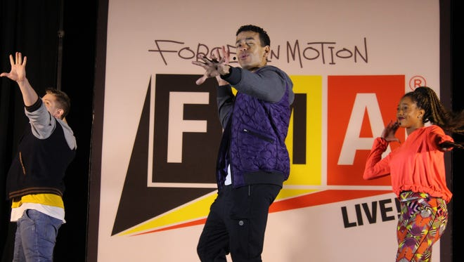Cast members from Forces in Motion FMA Live! perform for students at Mahaffey Middle School on Monday at Fort Campbell.