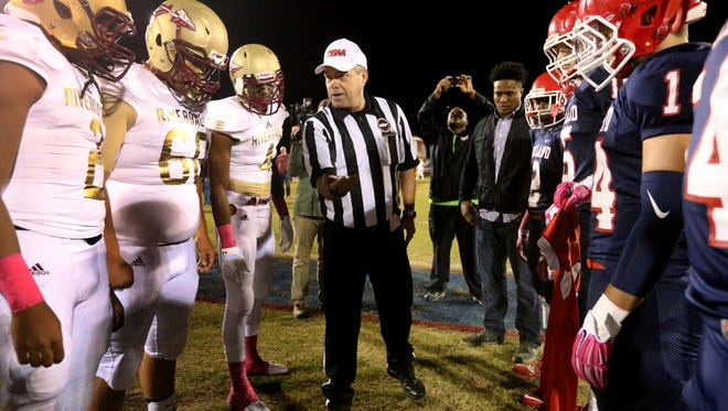Ref. David Porter flips a coin before the start of last month's Battle of the 'Boro between Oakland and Riverdale.