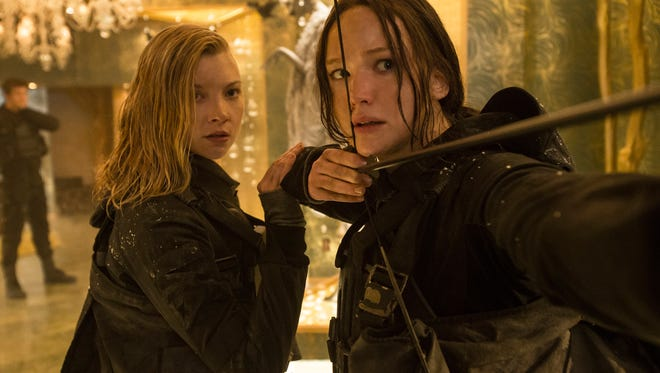 Cressida (Natalie Dormer, left) and Katniss Everdeen (Jennifer Lawrence) return to action in 'The Hunger Games: Mockingjay —  Part 2.'