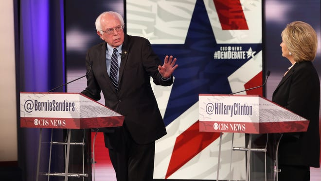 Vermont U.S. Sen. Bernie Sanders addresses  former Secretary of State Hillary Clinton during the Democratic presidential debate Saturday, Nov. 14, 2015, at Sheslow Auditorium on the campus of Drake University in Des Moines, Iowa.
