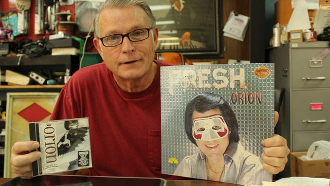 """Selma businessman Jerry Hatfield holds an album and CD recorded by the late Jimmy Ellis who performed as """"Orion."""""""