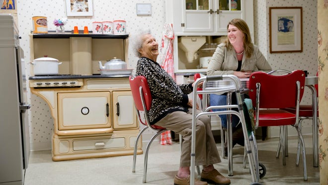 Olga Deacon, who has dementia, speaks with her granddaughter, Chris Boyce, in a replica 1940s kitchen in November at The Easton Home in Easton, Pa. Nursing homes and assisted living facilities are increasingly using sight, sound and other sensory cues to stimulate memory in people with Alzheimer's disease and other forms of dementia.