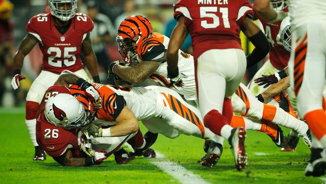 Cincinnati Bengals running back Jeremy Hill (32), center, dives into the end zone for a touchdown in the second quarter during Week 11 NFL game between the Cincinnati Bengals and Arizona Cardinals, Sunday, Nov. 22, 2015, at University of Phoenix Stadium in Glendale, Ariz.