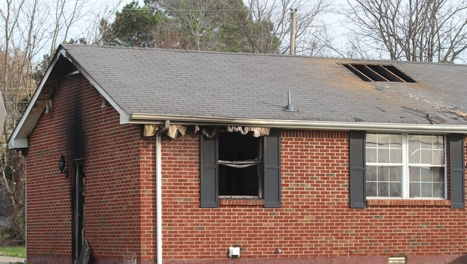 Fire heavily damaged the home at 407 Cunningham Lane on Monday.