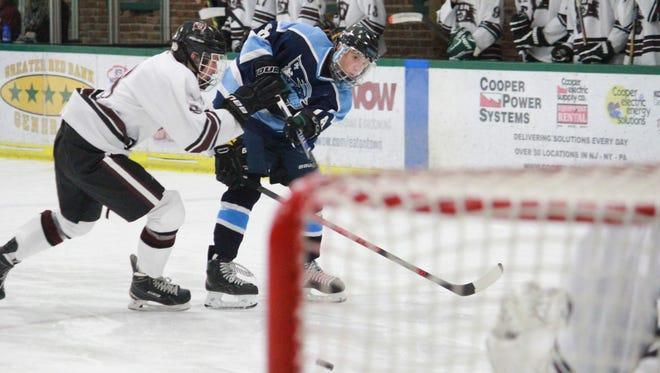 Freehold Township's Max Halvorsen seen firing a shot on net scored six goals in an 8-5 win over Red Bank.