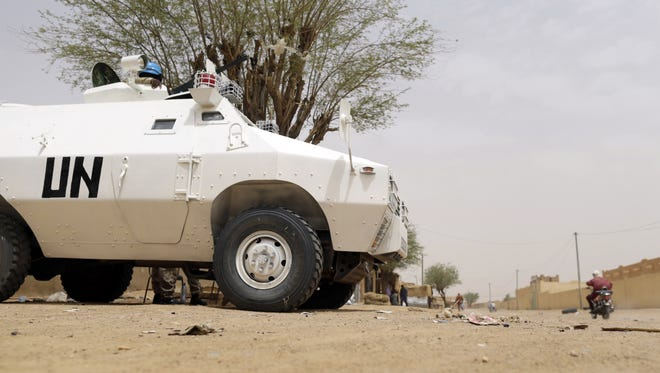 United Nations soldiers patrol in the northern Malian city of Kidal on July 27, 2013.