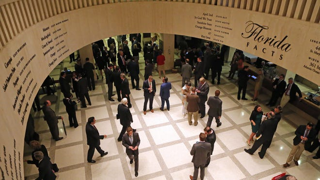 Lobbyists work in the rotunda between the House and Senate chambers during a session at the Capitol.
