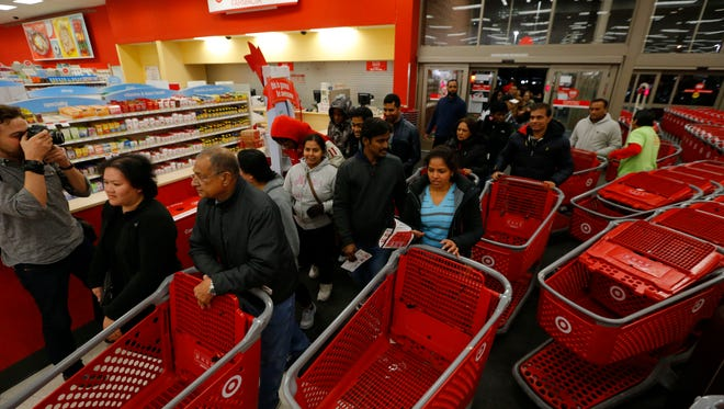 Customers flood into a Target in Jersey City, N.J. on Thanksgiving, Nov. 26, 2015. The retailer is experiencing record traffic to its site on Cyber Monday, which continues to lead to delays for some customers.