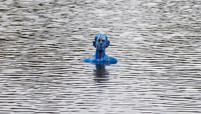 "One of the sculptures of the art-work ""Where the Tides Ebb and Flow"" by Argentinian artist Pedro Marzorati  to point on rising waters of the global warming, is installed in a pond at the Montsouris park during the COP21, United Nations Climate Change Conference, in Paris, Wednesday, Dec. 2, 2015. (AP Photo/Francois Mori)"