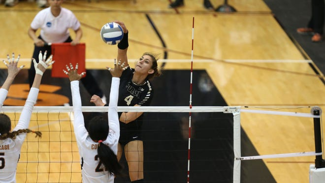 Purdue's Sam Epenesa with the spike against Texas during the second round of the NCAA tournament Friday night.