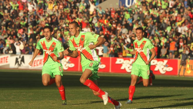 Edgar Mejia, from left, Wanderley De Jesus, and Gael Sandoval celebrate the first goal of the match Saturday.