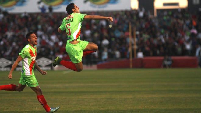 Edgar Mejia celebrates the second goal of the match Saturday in Juárez.