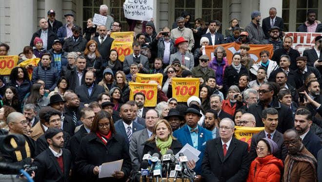 New York City Council Speaker Melissa Mark-Viverito, center, speaks during an interfaith rally at New York's City Hall in response to Republican presidential candidate Donald Trump's call to block Muslims from entering the United States, Wednesday, Dec. 9, 2015, in New York. (AP Photo/Mary Altaffer)