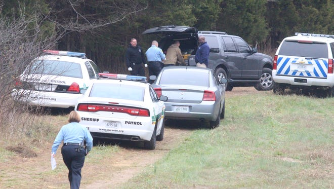 Montgomery County deputies work in a heavily wooded area of Palmyra after a body was found Thursday morning.