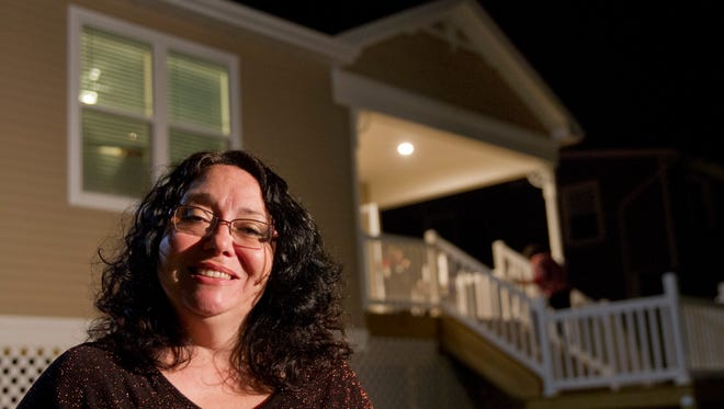 Marie Argibay-Boccasino outside of her house before a welcome home and blessing ceremony takes place.