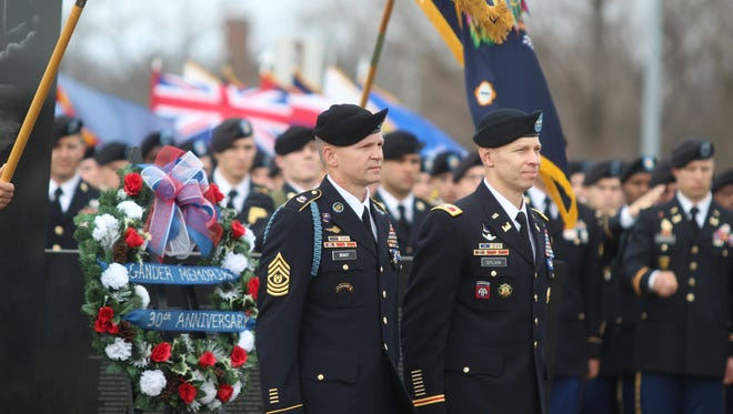 Col. Brett G. Sylvia, right, and Command Sgt. Maj. John A. Brady stand during Saturday's ceremony at Fort Campbell marking the 30th anniversary of the Gander, Newfoundland plane crash.