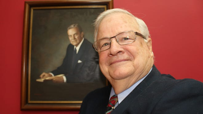 Selma attorney Ralph Hobbs stands in front of a portrait of his famous father Sam Earle Hobbs, former chairman of the board of trustees at the University of Alabama.