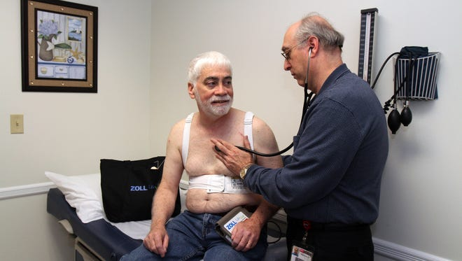 On Halloween night, 62-year-old Princeton physician's assistant Joe Thornton, a Somerville resident, experienced a sudden cardiac arrest in his sleep. His heart suddenly stopped beating, but Joe survived because he had been prescribed with a wearable defibrillator, the Zoll LifeVest. The device automatically detected his SCA and delivered treatment shocks that saved his life – six times. Joe Thornton wears a Zoll LifeVest during a visit with his cardiologist, Dr. Patrick Saulino, in Branchburg, NJ Friday December 18, 2015.